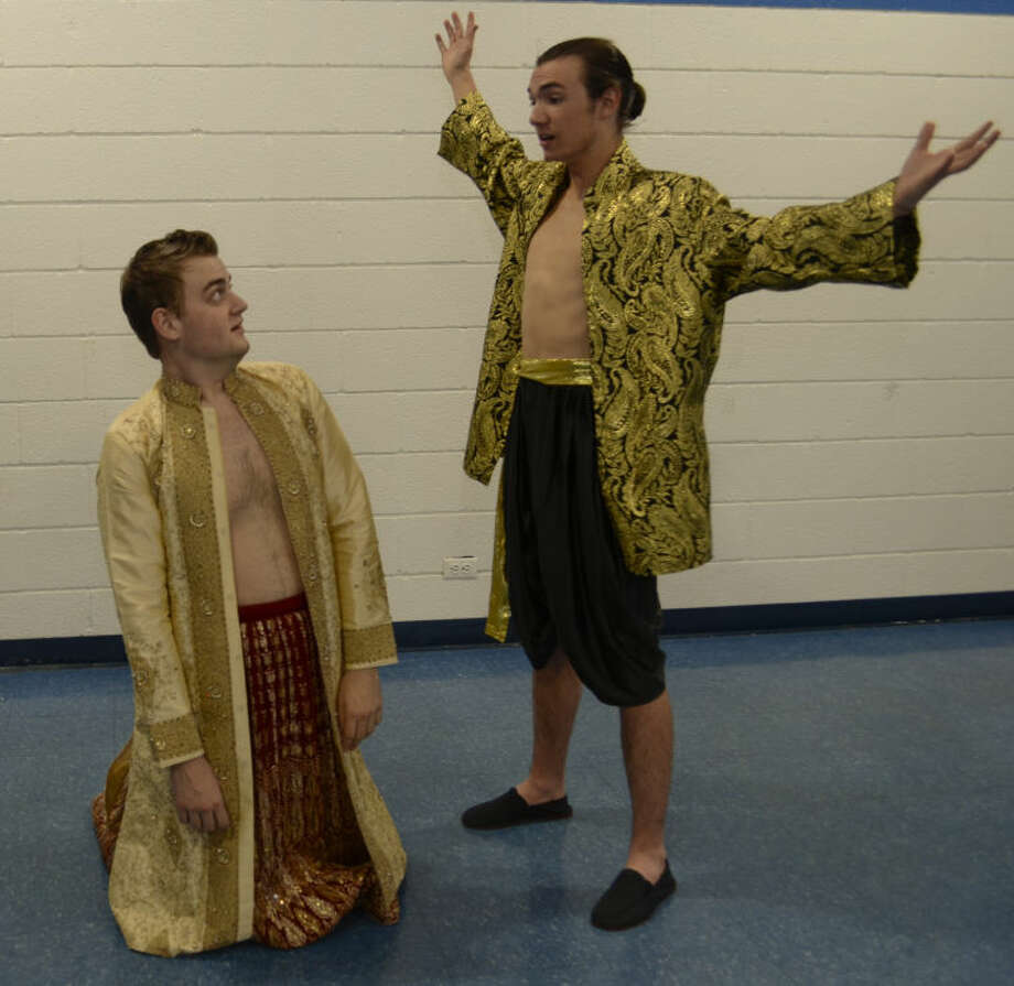 Corey Allcorn, kneels as Kralahome, while Zachary Lyon as The King stands over him in The King and I production at Trinity School. Tim Fischer\Reporter-Telegram Photo: Tim Fischer