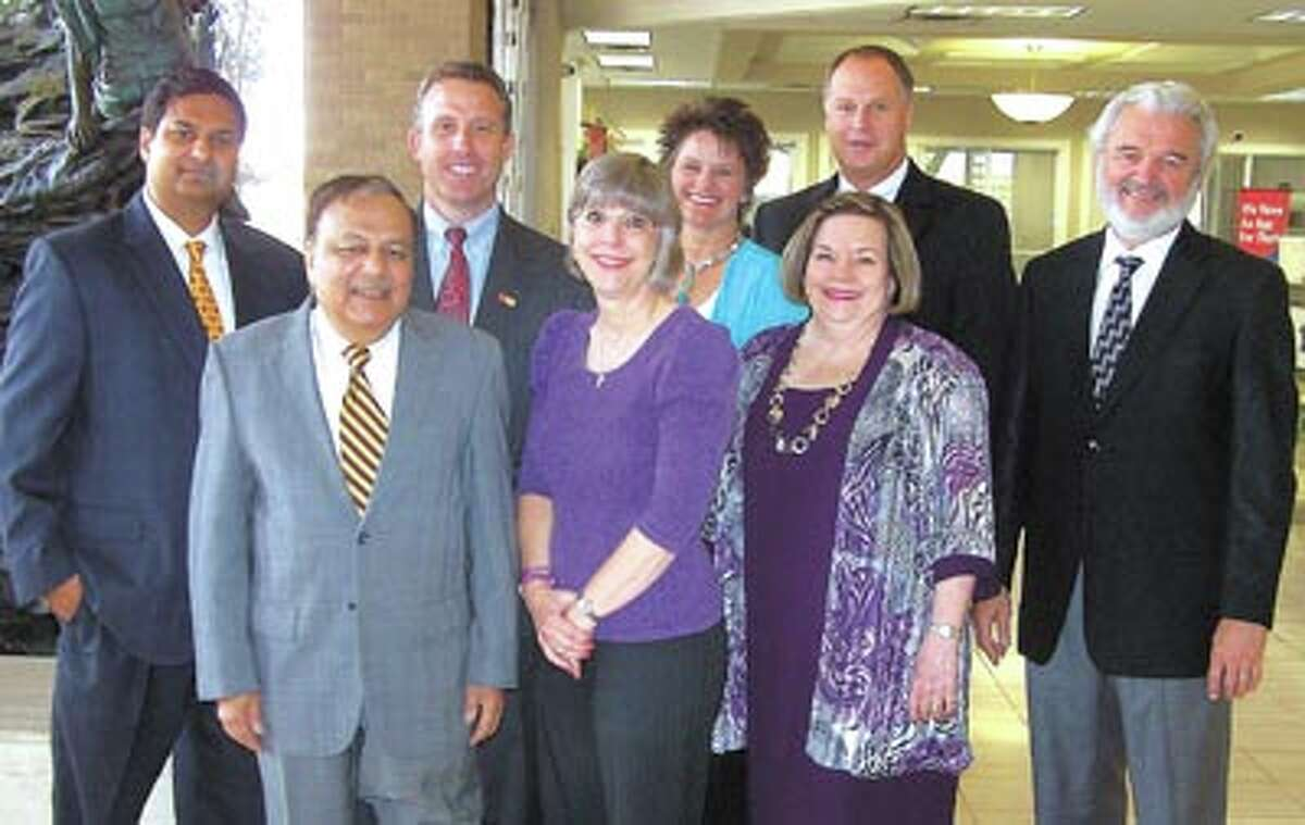 Call your Wells Fargo Financial Associate to learn more. They are, front row:: Bhupen Agrawal, Branch Manager, Carolyn Cotte, Client Associate, Carol Chandler Financial Advisor. Back row: Amit Agrawal VP, Investment Officer, Bill Franks, Financial Consultant, Stacy Wester, Client Associate, Forrest Wester, FVP, Investment Officer, Bill Braselton, Financial Advisor.