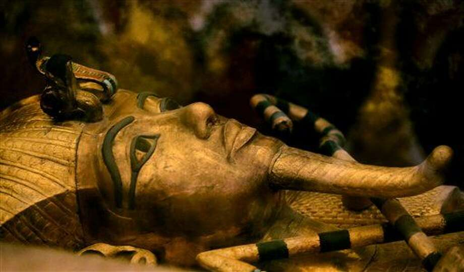 FILE - In this Thursday, Nov. 5, 2015 file photo, one of Egypt's famed King Tutankhamun's golden sarcophagus is displayed at his tomb in a glass case at the Valley of the Kings in Luxor. Egypt's Antiquities Minister Mamdouh el-Damaty, says during a press conference Thursday, March 17, 2016, that analysis of scans of famed King Tut's burial chamber has revealed two hidden rooms that could contain metal or organic material. (AP Photo/Amr Nabil) Photo: Amr Nabil