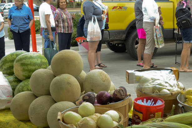 Patrons look over items available from different vendors at the Midland Downtown Farmers Market in this MRT file photo. Tim Fischer\Reporter-Telegram