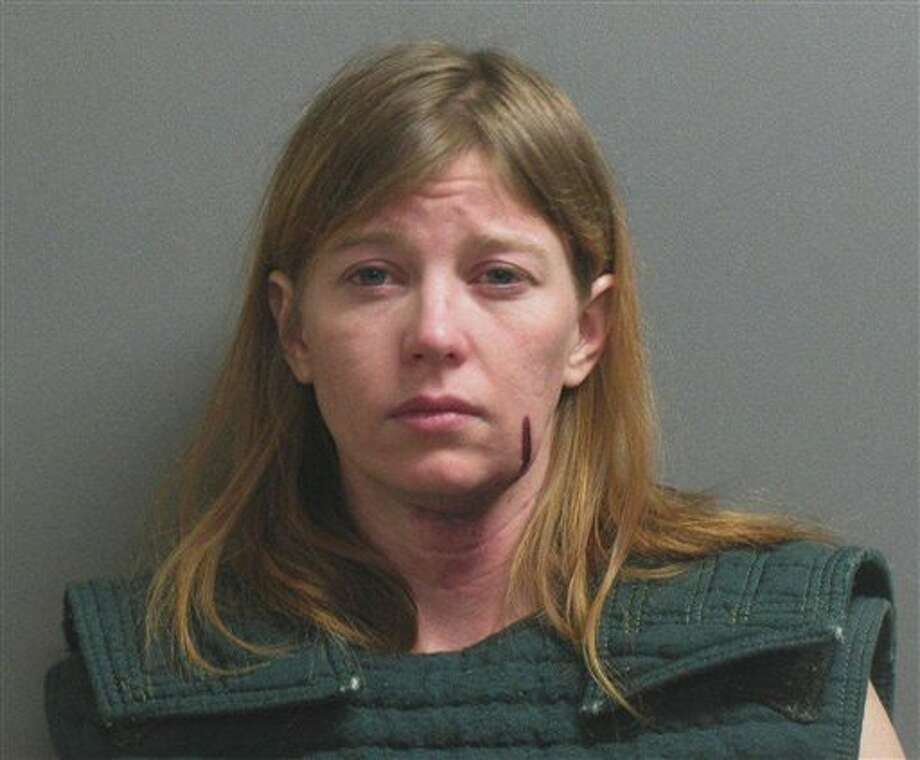 This undated photo provided by the Garza County Jail shows Ashlee Anne Dean. Dean, 34, the mother of a 2-year-old girl found fatally shot Thursday, Feb. 20, 2014 in their family's West Texas home, faces a capital murder charge in connection with her daughter's death. She is being held at the Garza County Jail in Post, Texas, about 40 miles southeast of Lubbock. (AP Photo/Garza County Jail) Photo: HOPD / Garza County Jail