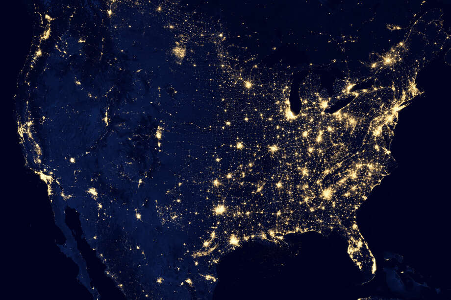 NASA satellite imagery from 2012 shows light from cities and oil and gas operations in Texas.  Photo: Courtesy Photo