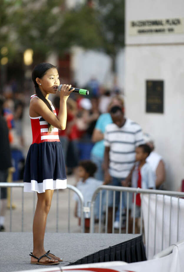 "Mackenzie Waker, age 10, of Lubbock, sings the ""Star Spangled Banner"" during the Star-Spangled Salute on Friday at Centennial Plaza. James Durbin/Reporter-Telegram Photo: James Durbin"
