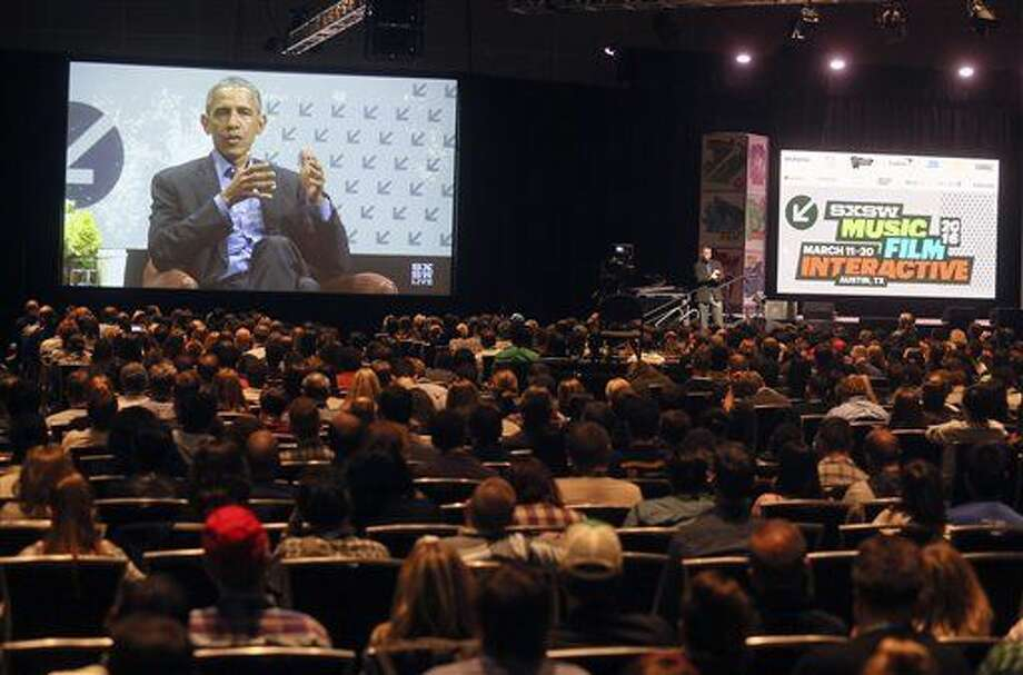 An overflow crowd at the Austin Convention Center watches a simulcast of President Barack Obama giving the opening keynote at the South by Southwest Interactive Festival on Friday, March 11, 2016, in Austin, Texas. (AP Photo/Jack Plunkett) Photo: Jack Plunkett