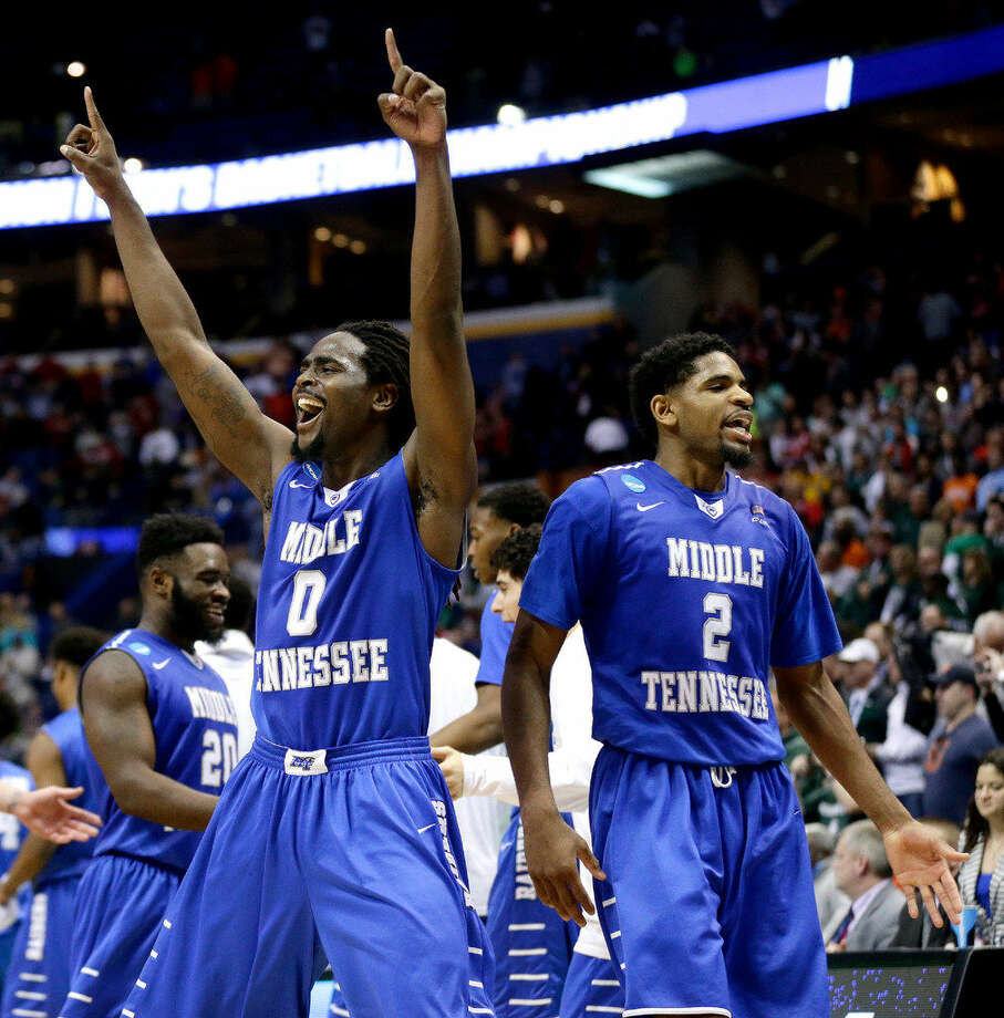 Middle Tennessee State's Darnell Harris (0) and Perrin Buford (2) celebrate as they walk off the court after winning a first-round men's college basketball game against Michigan State in the NCAA Tournament, Friday, March 18, 2016, in St. Louis. Middle Tennessee won 90-81. (AP Photo/Charlie Riedel)  Photo: Charlie Riedel | Associated Press