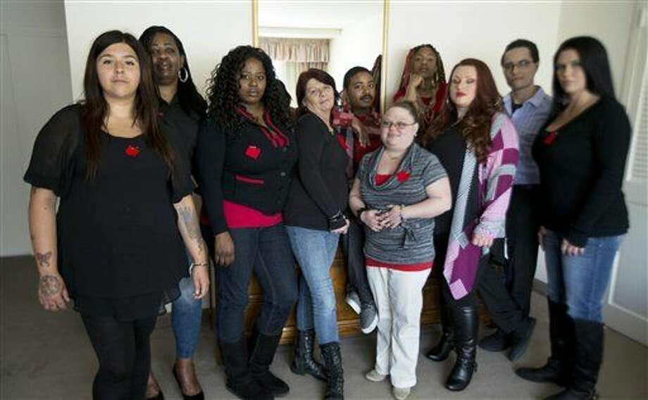 "Makenzie Vasquez, from left, Pamala Hunt, Latonya Suggs, Ann Bowers, Nathan Hornes, Ashlee Schmidt, Natasha Hornes, Tasha Courtright, Michael Adorno and Sarah Dieffenbacher, pose for a picture in Washington, Monday, March 30, 2015. Former and current college students calling themselves the ""Corinthian 100"" say they are on a debt strike and refuse to pay back their student loans. The name comes from Corinthian Colleges Inc., which operated the for-profit Everest College, Heald College and WyoTech schools before agreeing last summer to sell or close its 100-plus campuses. (AP Photo/Manuel Balce Ceneta) Photo: Manuel Balce Ceneta"