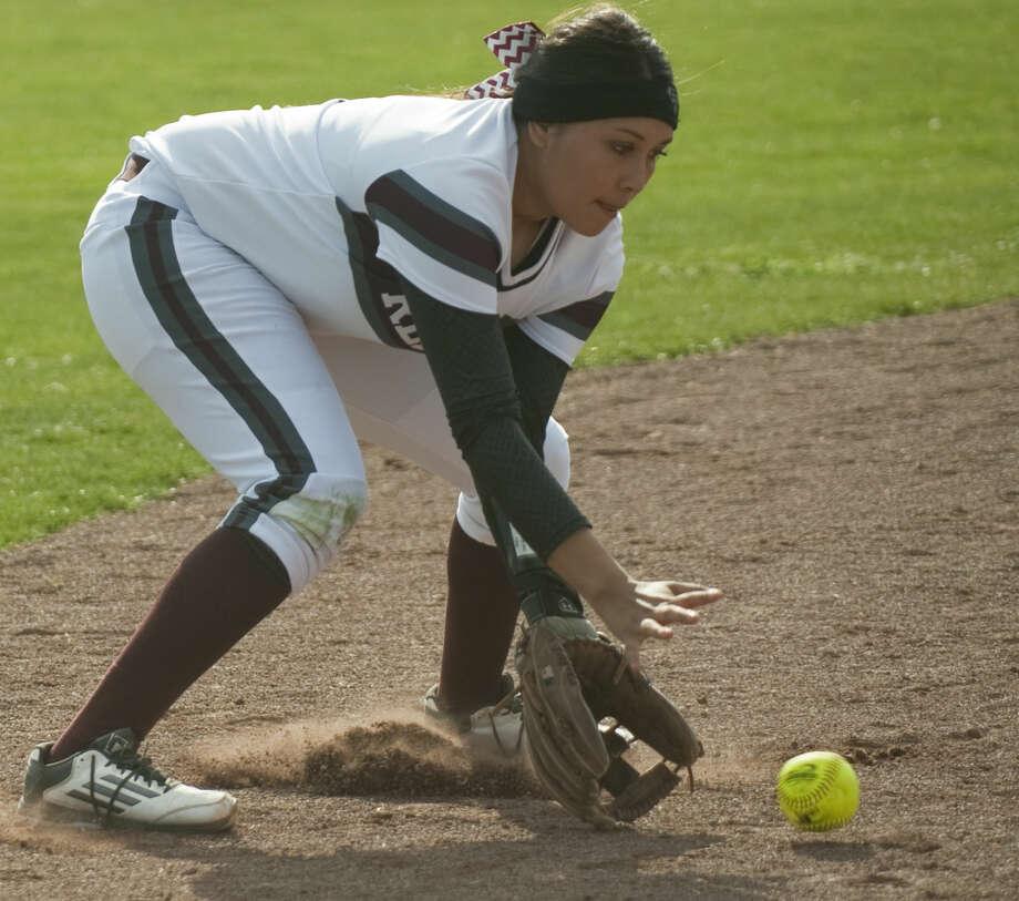 Lee High's Emily Nunez fields a hit up the middle Tuesday, 03-10-15, at Gene Smith Field. Tim Fischer\Reporter-Telegram Photo: Tim Fischer