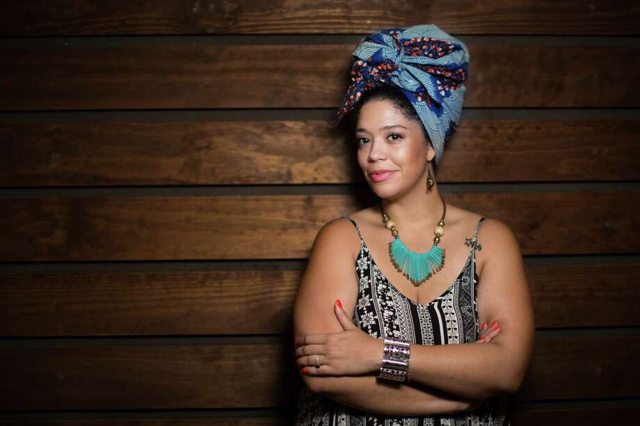 Lacey Huckaby, 29, is working on a book about her childhood growing up in a white home and later meeting her black birth mother. Photo: Marie D. De Jesus, Staff / © 2016 Houston Chronicle