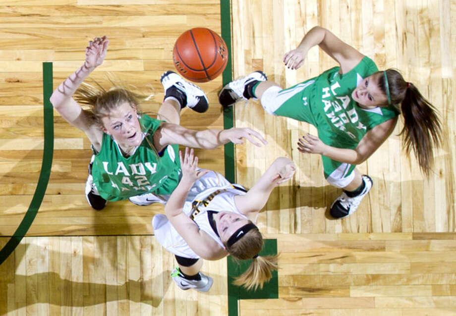 Wall's Maddi Chitsey (42) and Hannah Carr (30) try to snag a rebound from Canadian's Madisian Smith (2) during the Region 1-2A girls basketball tournament semifinal Friday at Chaparral Center. James Durbin/Reporter-Telegram Photo: JAMES DURBIN