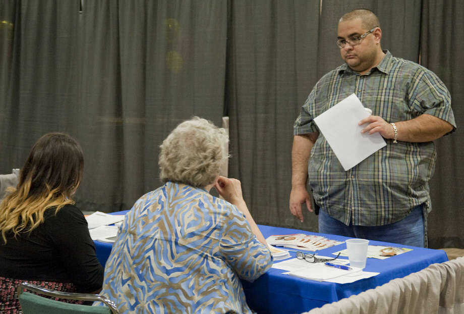 Chris Bloom talks with recruiters from the Department of Veterans Affairs Tuesday, 4-7-15, during the Midland Reporter-Telegram Career Fair at the Midland Center. Tim Fischer\Reporter-Telegram Photo: Tim Fischer