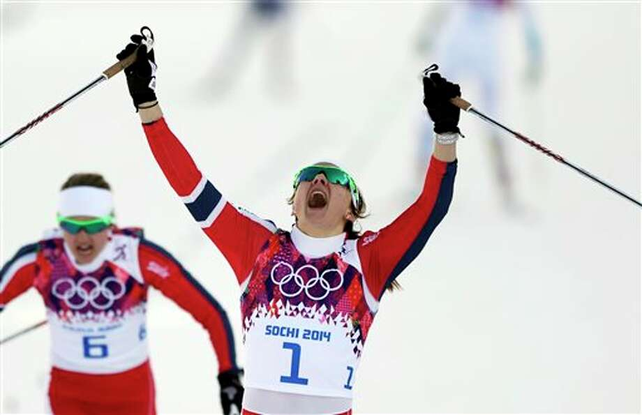 Norway's Maiken Caspersen Falla crosses the finish line to win gold in the final of the women's cross-country sprint at the 2014 Winter Olympics, Tuesday, Feb. 11, 2014, in Krasnaya Polyana, Russia. (AP Photo/Matthias Schrader, File) Photo: Matthias Schrader / AP