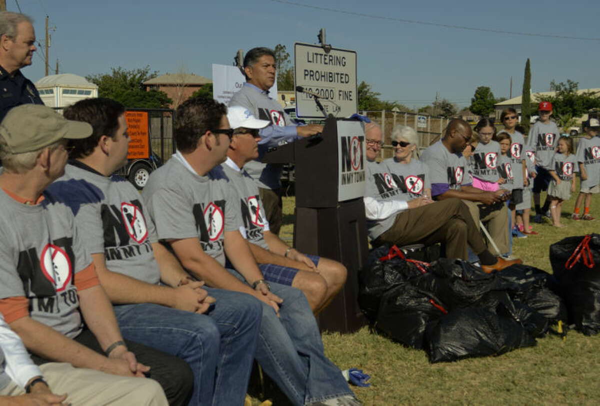 Mayor Jerry Morales helps kick off the anti-litter campaign, Not in My Town, Tuesday morning. Tim Fischer\Reporter-Telegram
