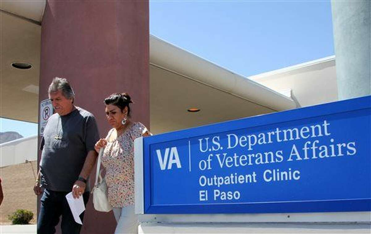 In this June 9, 2014 file photo, David and Marianne Trujillo exit the Vetarans Affairs facility in El Paso, Texas. In an analysis of six months of appointment data at 940 VA hospitals and clinics nationwide from September 2014 to February 2015, despite a nationwide push to lessen the wait times for veterans seeking health care, VA medical facilities across Texas have shown little to no sustained progress. The dilemma mirrors a trend across the country in which facilities are struggling to improve how often they meet the U.S. Department of Veterans Affairs' goal to have patients seen within 30 days. (AP Photo/Juan Carlos Llorca, File)