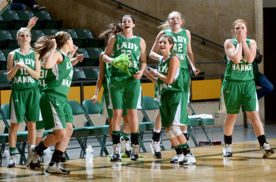 The Wall girls basketball team celebrates a win against Jim Ned as time runs out in the final game of the Region I-2A girls basketball tournament Saturday at Chaparral Center. James Durbin/Reporter-Telegram Photo: JAMES DURBIN
