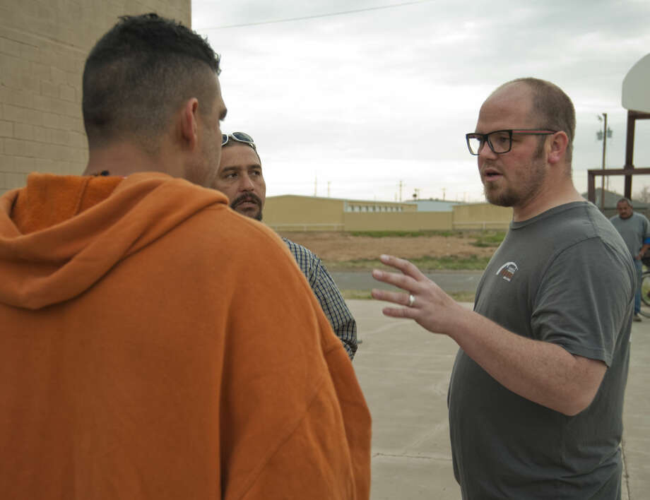 Evan Rogers talks with members of Church Under the Bridge Saturday, 3-14-15, sa they gather for fellowship and food. Tim Fischer\Reporter-Telegram Photo: Tim Fischer