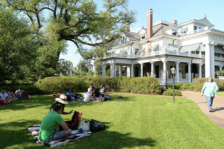 Families enjoy the spring picnic held at the McFaddin-Ward House Thursday. Families and friends gathered on the lawn to enjoy the semi-annual event which featured entertainment by Katie Whitney and the Draw. Photo taken Thursday, April 30, 2015Kim Brent/The Enterprise