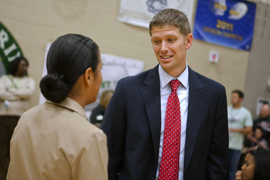 In this Nov. 11, 2014 photo, State Rep. Matt Krause chats with Kayla Colacion, a seventh-grader in the Young Marines of Tarrant County, at Trinity Springs Middle School in Keller, Texas. Krause authored one of several bills this legislative session that would tighten restrictions on pregnant teens who seek to get an abortion without their parents' permission. (AP Photo/The Fort Worth Star-Telegram, Juan Guajardo) MAGS OUT; (FORT WORTH WEEKLY, 360 WEST); INTERNET OUT Photo: Juan Guajardo