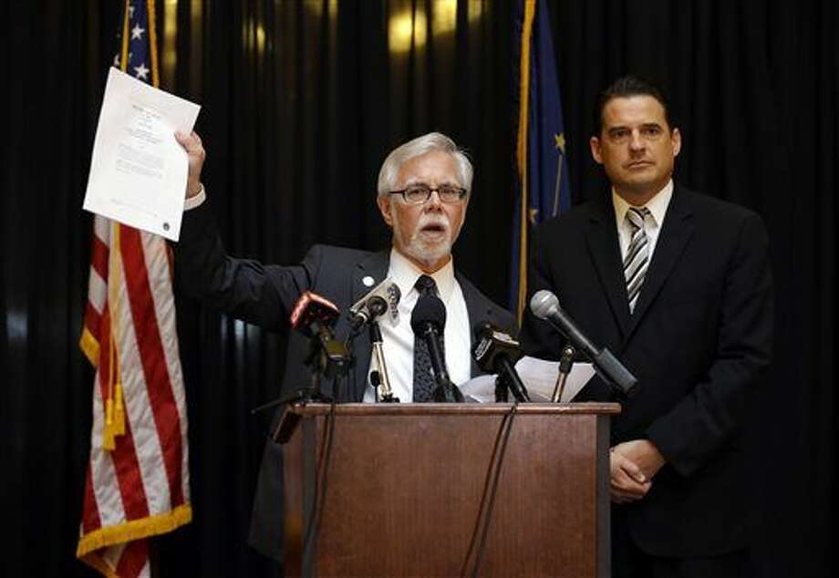 Indiana Senate Democratic Leader Tim Lanane, left, D-Anderson, and Indiana House Democratic Leader Scott Pelath, D-Michigan City, call for the repeal of the Indiana Religious Freedom Restoration Act during a news conference at the Statehouse in Indianapolis, Monday, March 30, 2015. Republican legislative leaders say they are working on adding language to a new state law to make it clear that it doesn't allow discrimination against gays and lesbians. (AP Photo/Michael Conroy) Photo: Michael Conroy