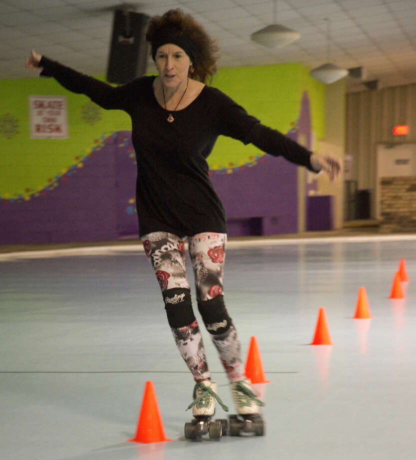 Lide Boyd weaves through cones as she makes her way around the rink Thursday 03-10-16 during Skate Fit at KC Nutty Roller. Tim Fischer\Reporter-Telegram Photo: Tim Fischer
