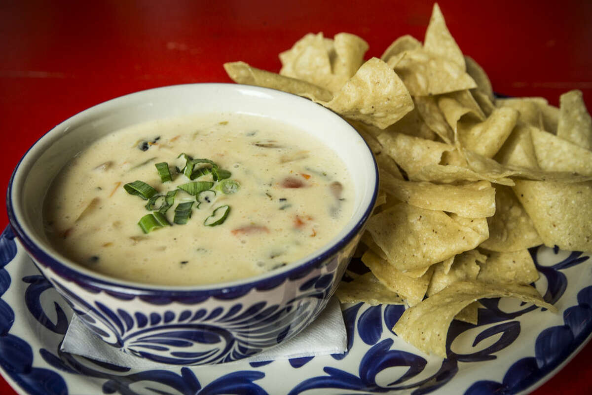 A plate of chili con queso and chips is shown at The El Cantina Superior on Friday, April 3, 2015, in Houston. ( Brett Coomer / Houston Chronicle )