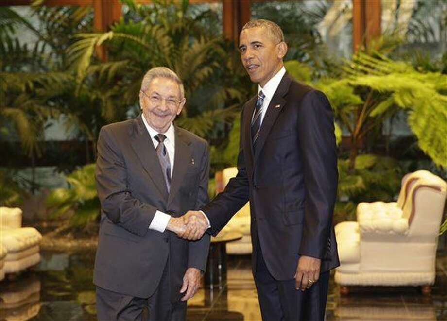 Cuban President Raul Castro, left, shakes hands with U.S. President Barack Obama during a meeting in Revolution Palace, Monday, March 21, 2016. Brushing past profound differences, President Obama and President Castro sat down for a historic meeting, offering critical clues about whether Obama's sharp U-turn in policy will be fully reciprocated. (AP Photo/Ramon Espinosa) Photo: Ramon Espinosa