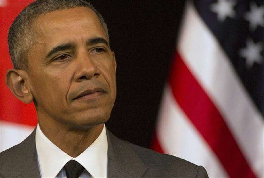 """United States President Barack Obama speaks to the Cuban people at the National Theater in Havana, Cuba, Tuesday, March 22, 2016. Obama started his speech by pledging that the U.S. will """"do whatever is necessary"""" to help Belgium bring to justice those who carried out the terrorist attacks in Brussels and went on to urge Cubans to look to the future with hope, casting his historic visit as a moment to """"bury the last remnants of the Cold War in the Americas.""""(AP Photo/Desmond Boylan)"""