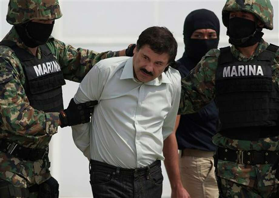 "In this 2014 photo, Joaquin ""El Chapo"" Guzman is escorted to a helicopter in handcuffs by Mexican navy marines at a navy hanger in Mexico City, Mexico. Guzman, the head of Mexico's Sinaloa Cartel, escaped from a maximum security prison Photo: Eduardo Verdugo / AP"
