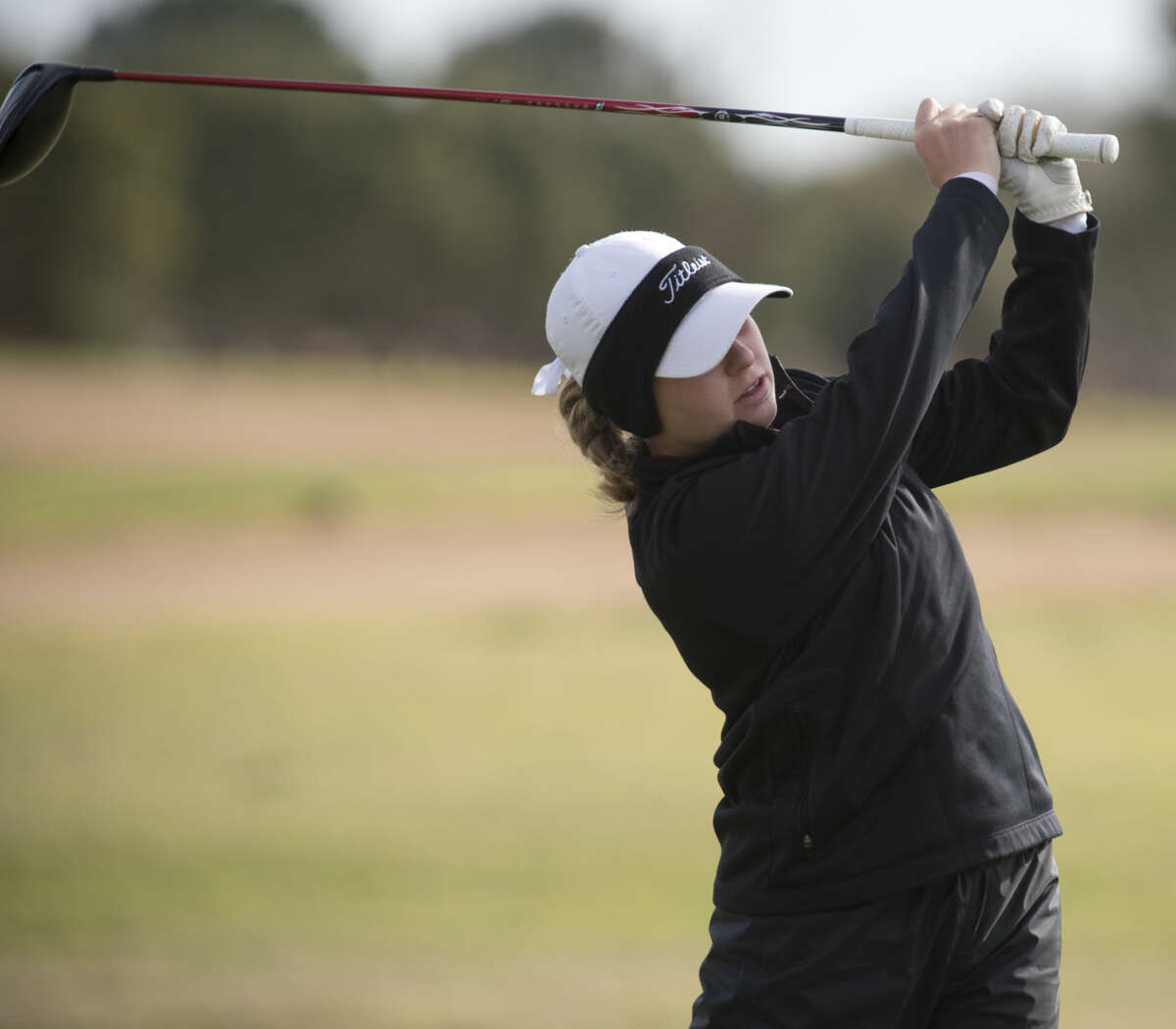 Lee High's Rebecca Reed follows her shot Tuesday 03-22-16 during the District 3-6A golf tournament at Greentree Country Club. Tim Fischer\Reporter-Telegram