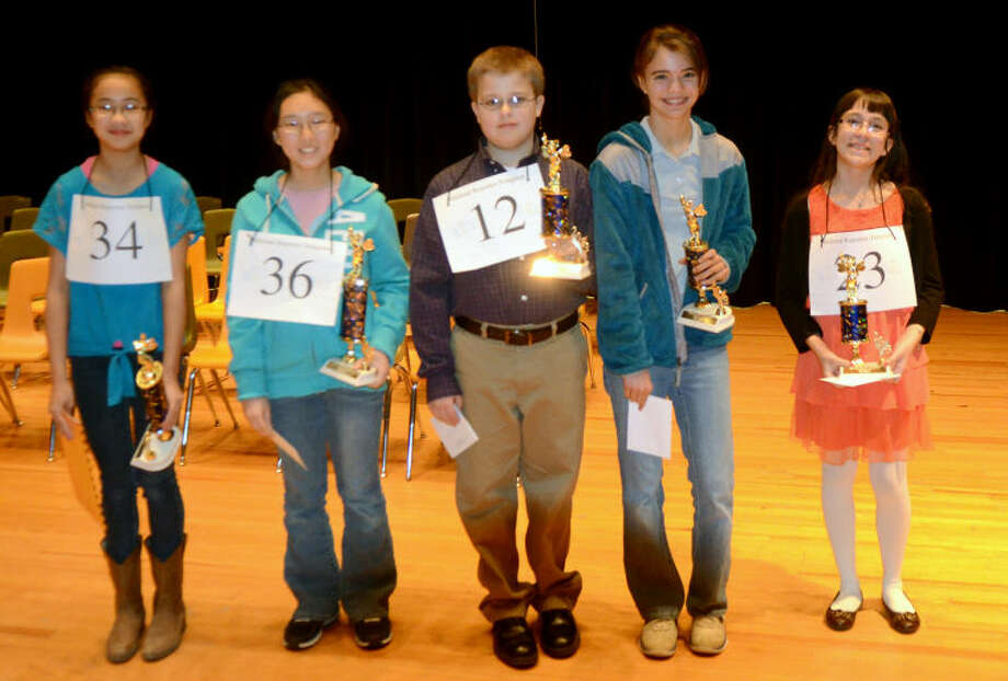 (File Photo) Top five finalists from left, Gabrielle Rubio, Sophia Koo, Christian Bell, Claire Keck and Nikkie Galindo pose for a picture after the 26th Annual Midland Reporter-Telegram Regional Spelling Bee on Saturday in the Midland College Allison Fine Arts building. James Durbin/Reporter-Telegram Photo: JAMES DURBIN