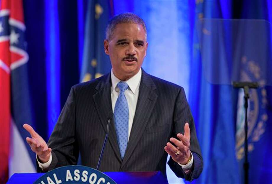 Attorney General Eric Holder speaks at the annual Attorneys General Winter Meeting in Washington, Tuesday, Feb. 25, 2014. Holder said state attorneys general are not obligated to defend laws in their states banning same sex-marriage if they don't believe in them. (AP Photo/Manuel Balce Ceneta) Photo: Manuel Balce Ceneta / AP