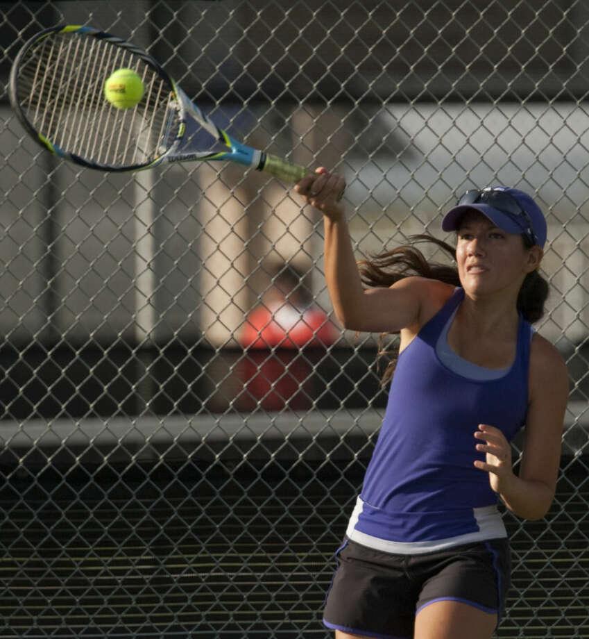 Midland High's Mickey Jimenez returns a shot Thursday, 4-9-15, during a District 3-6A tennis tournament at Bush Tennis Center. Tim Fischer\Reporter-Telegram Photo: Tim Fischer
