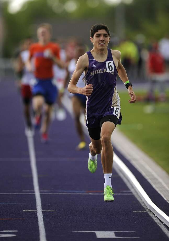 Midland High's Bryce Hoppel leads the pack to the finish line to win the boys 800 meter race during the District 3/4-6A Area Track Meet on Friday, April 24, 2015, at Elmer Gray Stadium in Abilene. Tommy Metthe/Abilene Reporter-News Photo: Tommy Metthe/Abilene Reporter-News