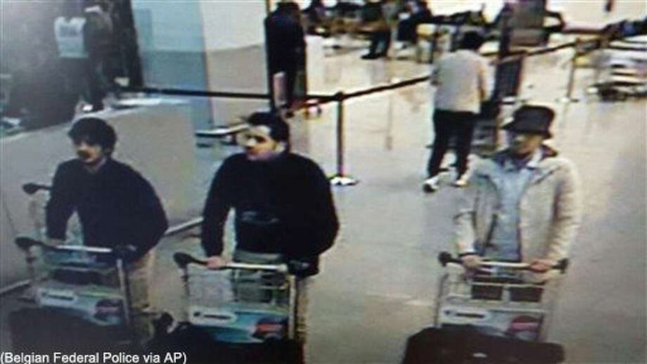 In this image provided by the Belgian Federal Police in Brussels on Tuesday, March 22, 2016 of three men who are suspected of taking part in the attacks at Belgium's Zaventem Airport. The man at right is still being sought by the police and two others in the photo that the police issued were according to a the Belgian Prosecutors 'probably' suicide bombers. Bombs exploded at the Brussels airport and one of the city's metro stations Tuesday, killing and wounding scores of people, as a European capital was again locked down amid heightened security threats. (Belgian Federal Police via AP) Photo: HOGP