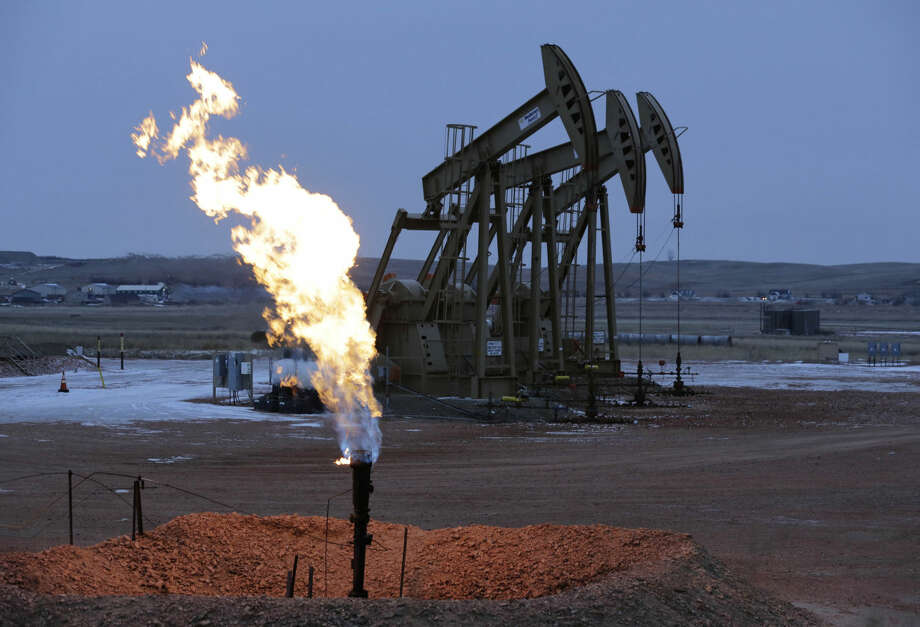 In April 2012, the EPA issued its first federal air standards for hydraulically fractured wells producing natural gas. The standards called for reduced emissions of fracturing wells, and required fractured wells to release their stranded gas emissions through combustion devices, or flares, rather than straight into the atmosphere. The state withdrew its case two months after filing it. The case cost $5,450. Photo: Eric Gay