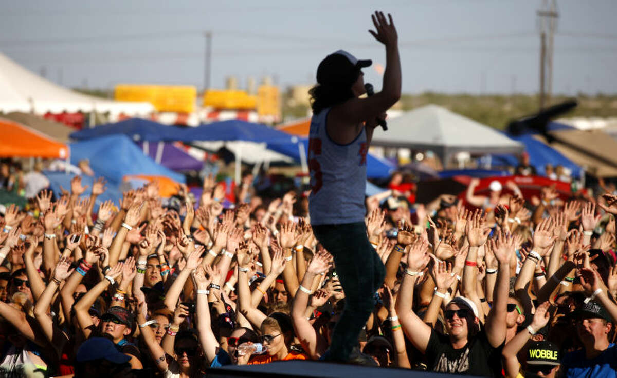 """(File Photo) Fans participate in a performance by the band """"Family Force 5"""" during Rock The Desert on Saturday. James Durbin/Reporter-Telegram"""