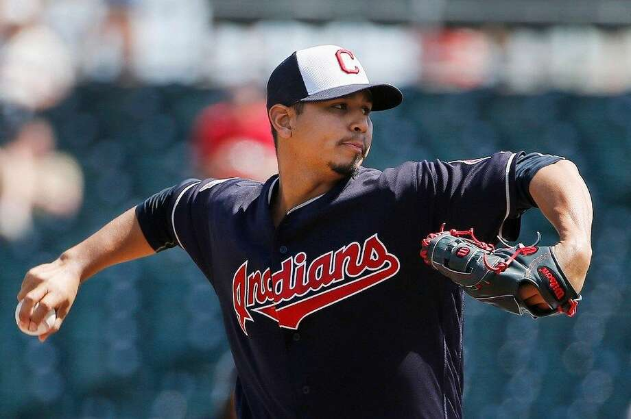 Cleveland Indians' Carlos Carrasco prepares to throw a pitch against the Chicago White Sox during the first inning of a spring training baseball game Monday, March 21, 2016, in Goodyear, Ariz. (AP Photo/Ross D. Franklin) Photo: Ross D. Franklin | Associated Press
