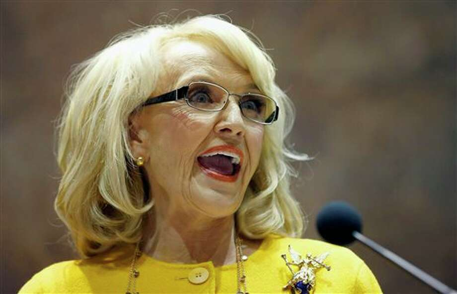 FILE - In this Jan. 13, 2014 file photo, Arizona Gov. Jan Brewer speaks during her State of the State address at the Arizona Capitol in Phoenix. The Republican governor faced intensifying pressure Tuesday from CEOs, politicians in Washington and state lawmakers in her own party to veto a bill that would allow business owners with strongly held religious beliefs to deny service to gays and lesbians. (AP Photo/Ross D. Franklin, File) Photo: Ross D. Franklin / ap