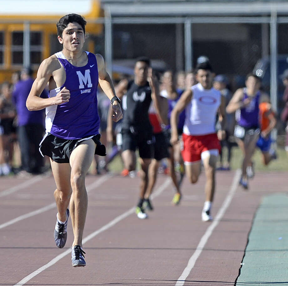 Midland High's Bryce Hoppel leads the back during the 800 meter event of the Tall City Relays track and field meet on Thursday, March, 24, 2016, at Memorial Stadium. James Durbin/Reporter-Telegram