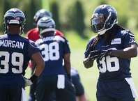 Rookie running back Alex Collins gets in line during the first day of the Seahawk's rookie minicamp on Friday, May 6, 2016 at Virginia Mason Athletic Center.