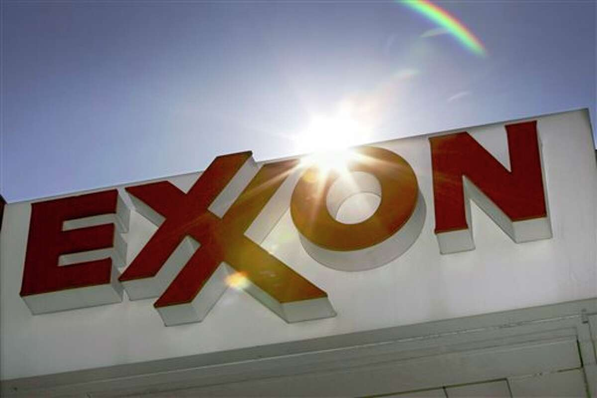 FILE - This Oct. 26, 2006, file photo, shows an Exxon logo seen at a Dallas gas station. Exxon Mobil's annual long-term energy outlook, released Thursday, Dec. 12, 2013, predicts world energy demand will grow 35 percent by 2040 as electricity and modern fuels are brought to some of the billions of people in the developing world who currently live without power or burn wood or other biomass for cooking and heating. (AP Photo/LM Otero, File)
