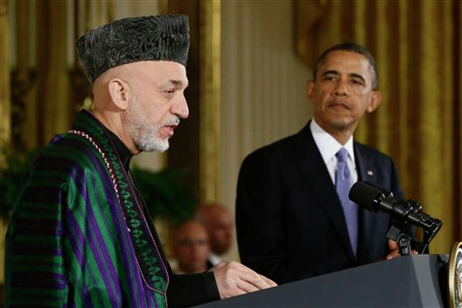 FILE - This Jan. 11, 2013 file photo shows President Barack Obama listening as Afghan President Hamid Karzai speaks during a news conference in the East Room at the White House in Washington. President Barack Obama has ordered the Pentagon to plan for a full American withdrawal from Afghanistan by the end of this year should the Afghan government refuse to sign a security agreement with the US the White House said Tuesday. (AP Photo/Charles Dharapak, File) Photo: Charles Dharapak / AP
