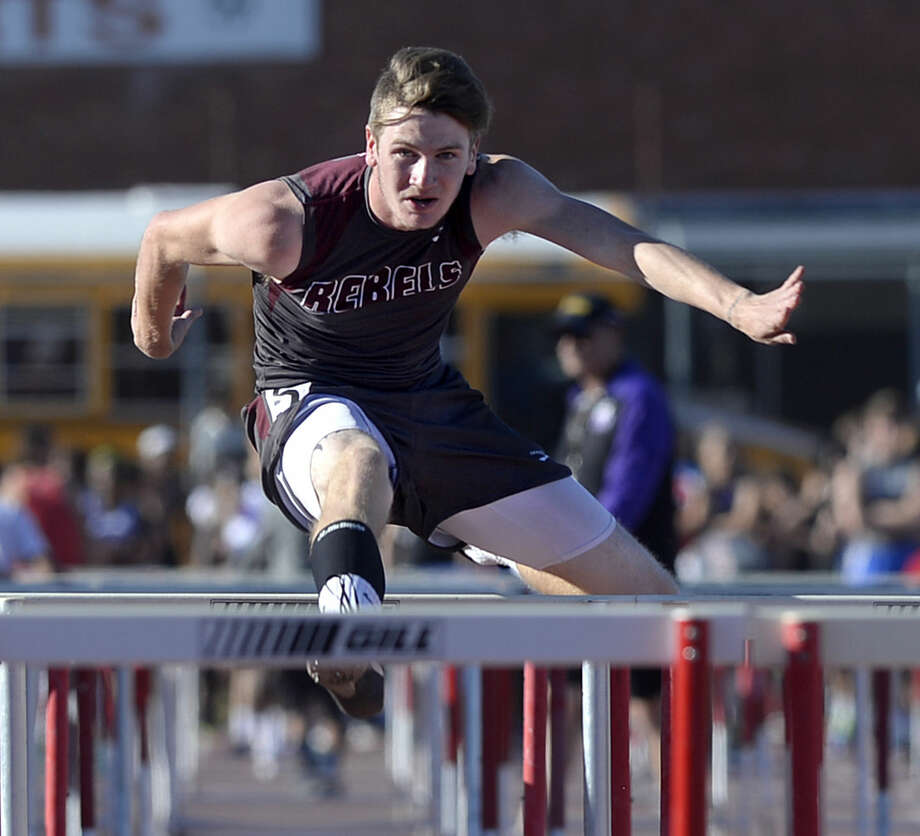 Lee's Denim Rogers competes in the 100 meter hurdle event of the Tall City Invitational track and field meet on Thursday, March, 24, 2016, at Memorial Stadium. James Durbin/Reporter-Telegram Photo: James Durbin