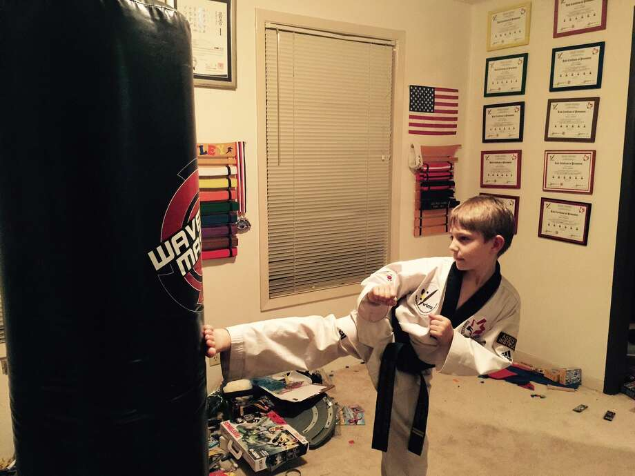 Riley Hardin, 8, practices taekwondo at his home. Photo: Courtesy Photo