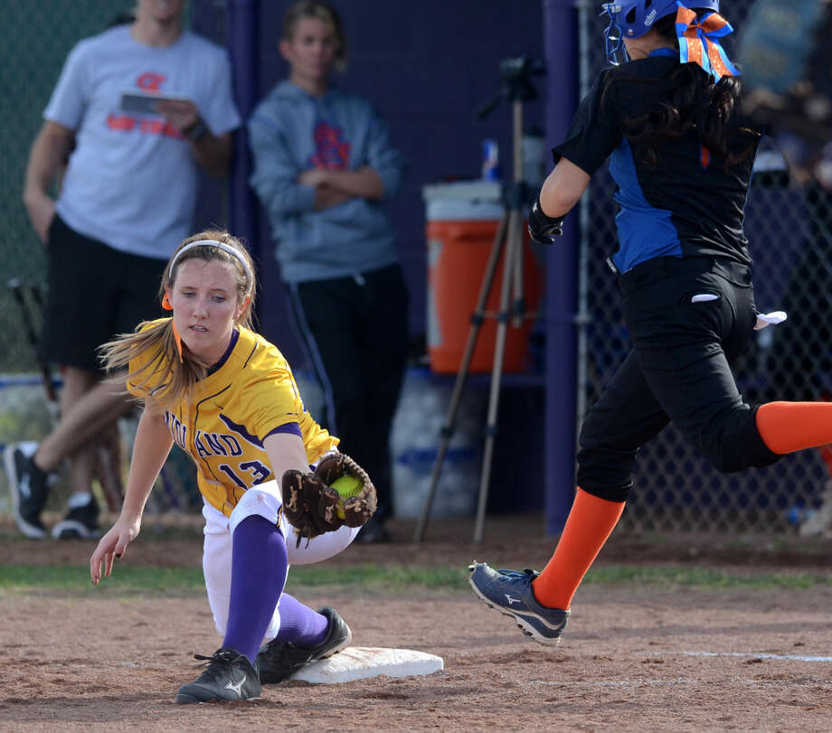 Midland High's Aubrey Elliott gets an out at first base against San Angelo Central on Thursday, March, 19, 2015, at Audrey Gill Sports Complex. Midland High beat San Angelo Central 14-2. James Durbin/Reporter-Telegram Photo: James Durbin