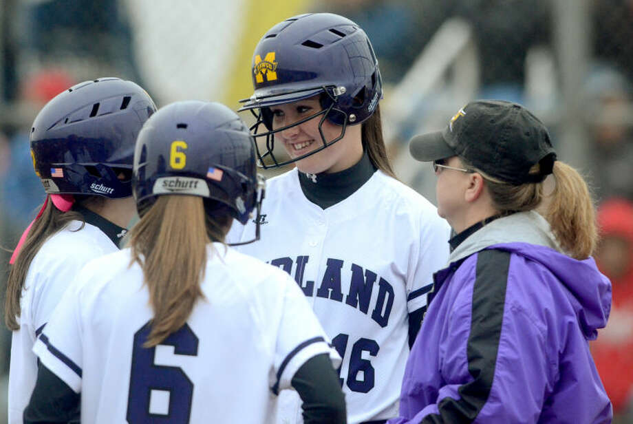 Midland High's Shelby Neatherlin (16) talks to teammates on the mound during the game against Odessa High on Tuesday at Audrey Gill Sports Complex. James Durbin/Reporter-Telegram Photo: JAMES DURBIN