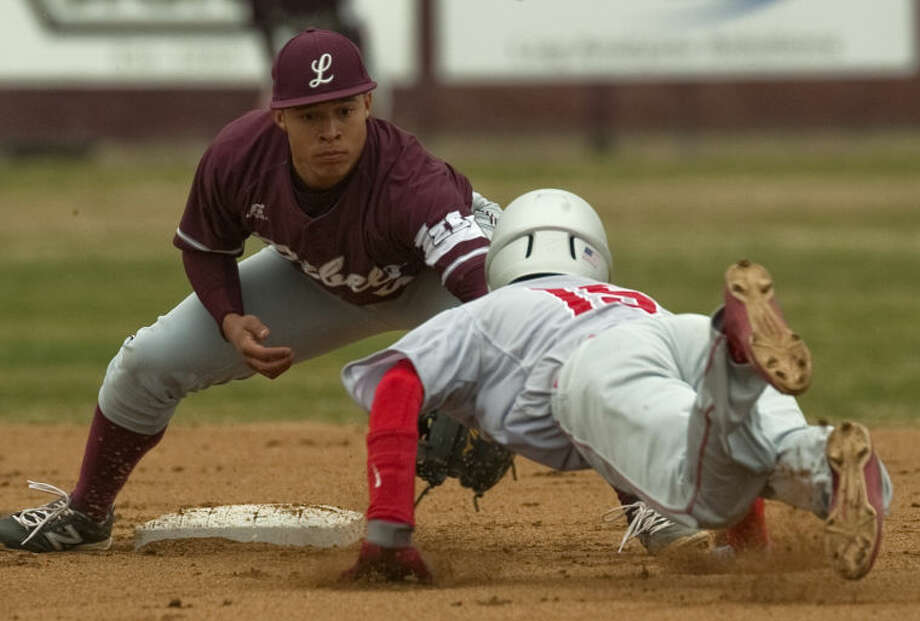 Lee High's Rayon Calhoun puts the tag on Odessa High's Andrew Lara trying to steal second Tuesday afternoon at Ernie Johnson Field. Tim Fischer\Reporter-Telegram Photo: Tim Fischer