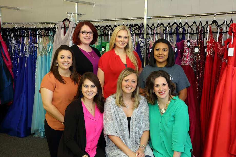 Janee's Bridal & Formal has donated more than 200 dresses to the Perfect PROMise, a project of 3:11 Ministries that provides dress and shoes to high school girls who would otherwise be unable to attend prom. Standing from left are Chelsea Gonzales, Janee's owner Megan Perkins, Suzanne Quain and Katrina Hernandez. Seated from left are Andrea Garza, Stephanie Wilbanks and Margaret Gregg.