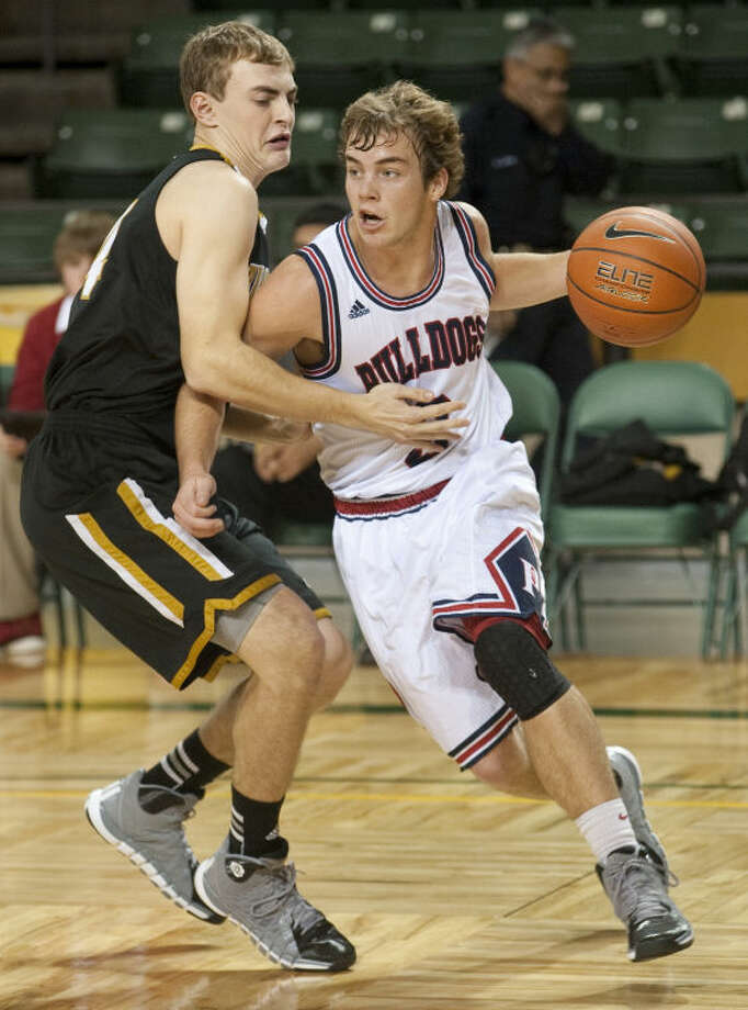Plainview's Karson Hembree drives baseline around Bushland's Blane Barnett Dec. 28 in the third place game of the Bryon Johnston Holiday Classic in Midland. Tim Fischer\Reporter-Telegram Photo: Tim Fischer