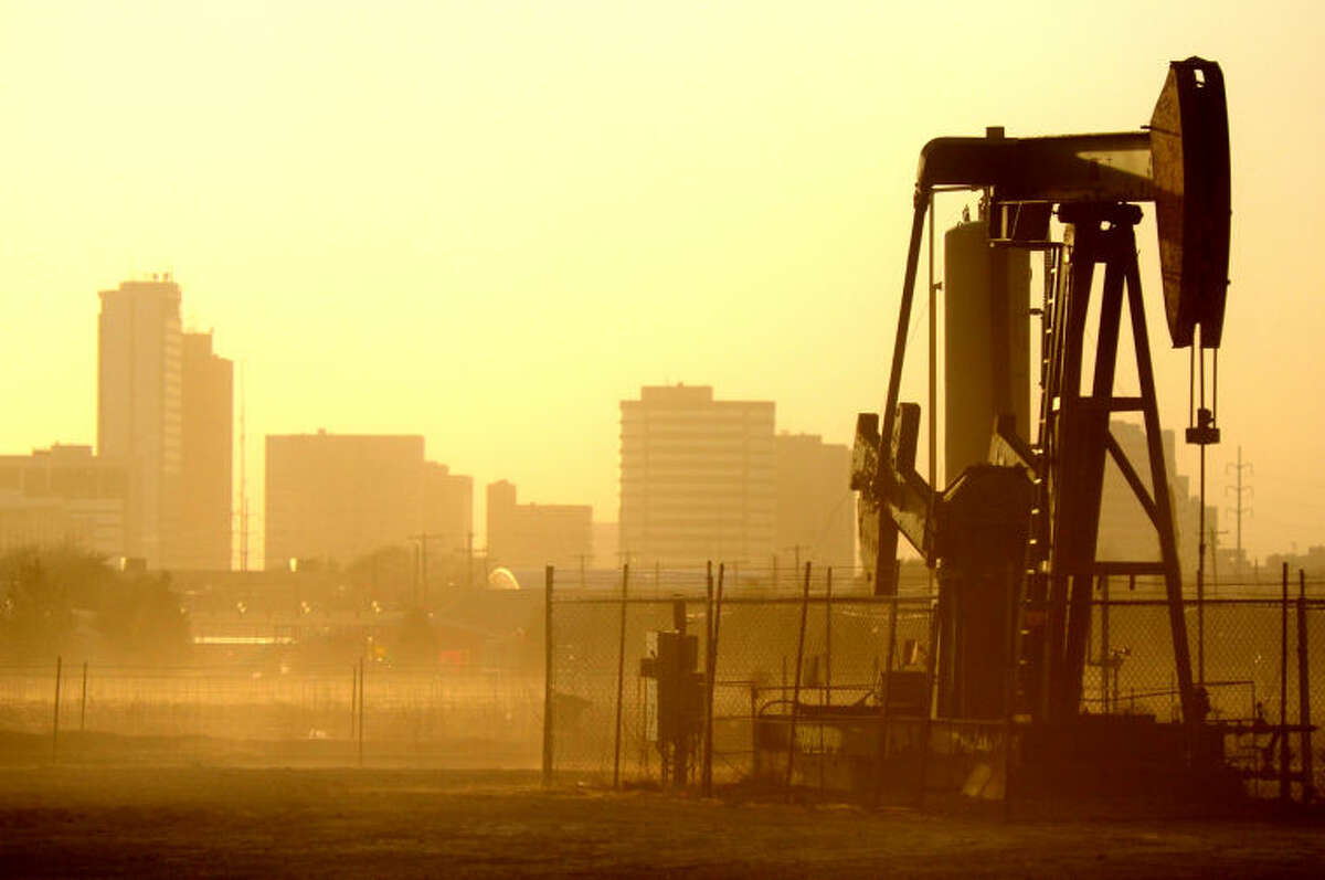 Dust partially obscures the Midland skyline viewed from Fairgrounds Rd. during a windstorm Jan. 29, 2013. James Durbin/Reporter-Telegram