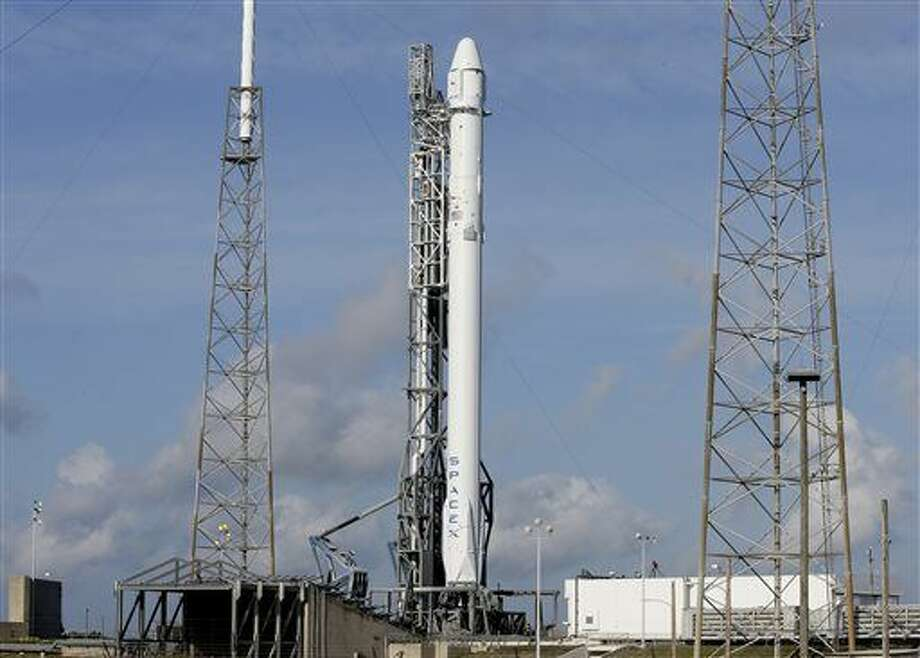 After a scrub on Monday, the Falcon 9 SpaceX rocket stands ready for another launch attempt at complex 40 at the Cape Canaveral Air Force Station in Cape Canaveral, Fla., Tuesday, April 14, 2015. This will be SpaceX's sixth commercial resupply services mission to the International Space Station. (AP Photo/John Raoux) Photo: John Raoux